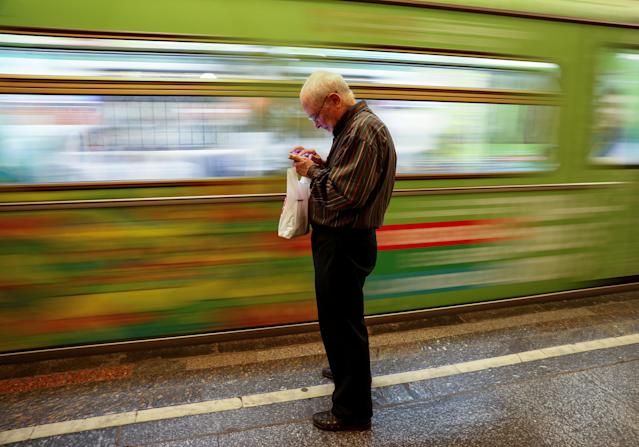A man uses his mobile phone at a subway station in Moscow, Russia, June 22, 2018. As well as shooting all the matches, Reuters photographers are producing pictures showing their own quirky view from the sidelines of the World Cup. REUTERS/Gleb Garanich