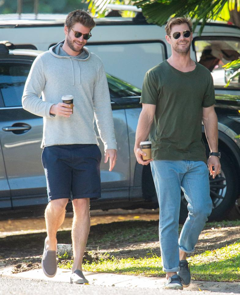 Brothers Liam and Chris Hemsworth grab coffee while out near Byron Bay, Australia, on Thursday.