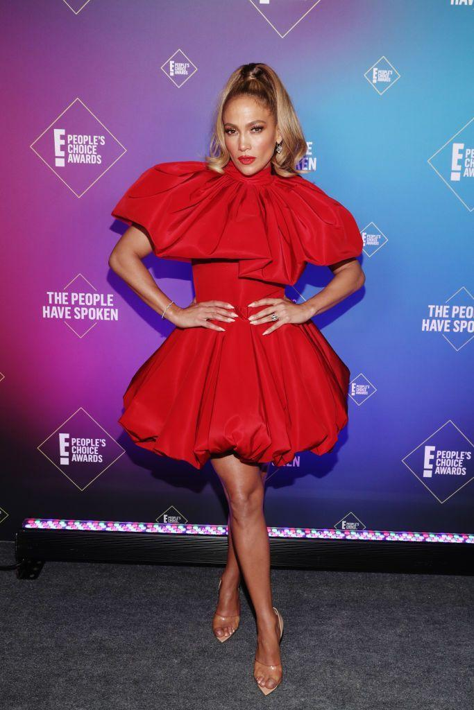 <p>Jennifer Lopez pulled out all the stops for a rare 2020 red-carpet appearance as she arrived at the People's Choice Awards. The actress and singer posed in a red mini dress by Christian Siriano, which featured a bubble hem, cape detail and a nipped-in waist. Lopez teamed the look with a high ponytail, a red lip and a pair of nude heels. A perfect look for the occasion.</p>
