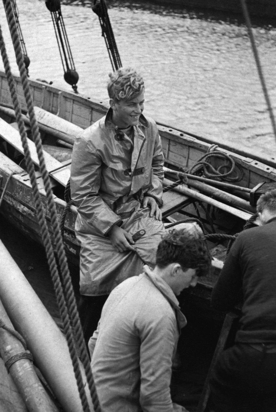 <p>The future Duke of Edinburgh grinned during a sailing trip as a young man. Photo: Getty Images.</p>