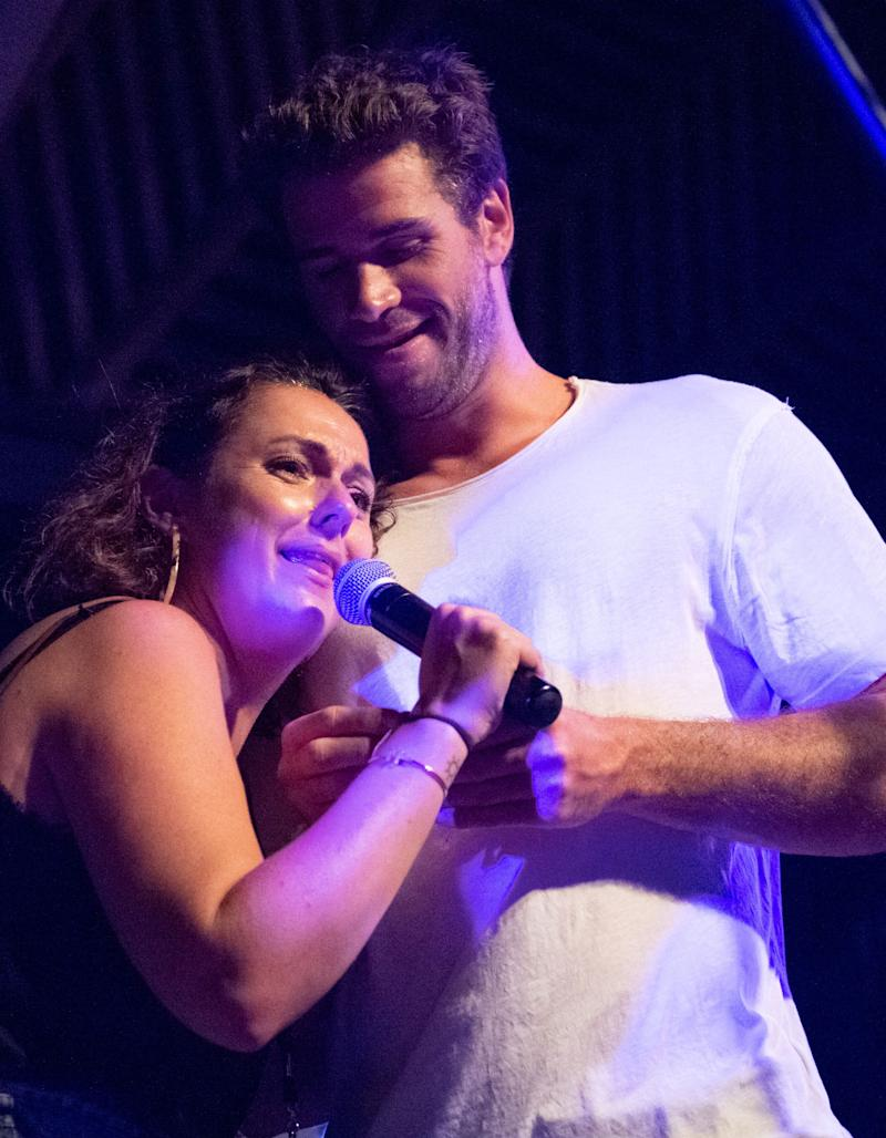 Celeste Barber on stage with Liam Hemsworth at the bushfire relief fundraiser