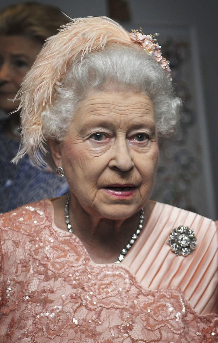 Queen Elizabeth II arrives for the Opening Ceremony of the 2012 Olympic Summer Games at the Olympic Stadium in London, Friday, July 27, 2012. (AP Photo/John Stillwell, Pool)