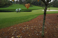 Course marshalls walk along the 16th fairway during a practice round for the Masters golf tournament Wednesday, Nov. 11, 2020, in Augusta, Ga. (AP Photo/Charlie Riedel)