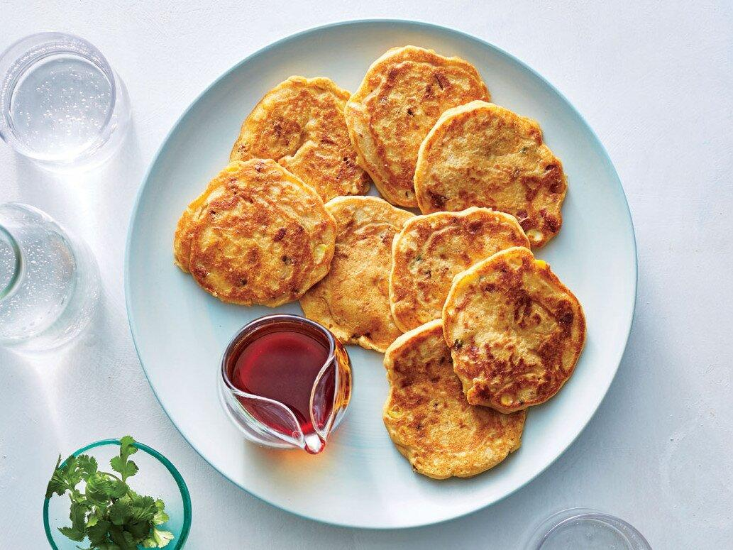 """<p>Is there any time of day when a pancake isn't welcome at the table? These sweet and savory cakes are a scrumptious choice for breakfast, dinner, or a quick snack on the go. Keep warm and toasty by placing them in a single layer on a baking sheet in a 200°F oven for up to 30 minutes. Reheating is as easy as popping frozen cakes in the toaster, making them ideal for quick weekday meals.</p> <p><a href=""""https://www.myrecipes.com/recipe/spanish-chorizo-corn-cakes"""">Spanish Chorizo Corn Cakes Recipe</a></p>"""