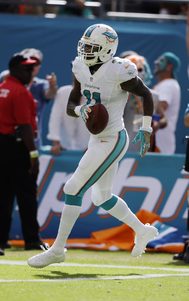 Miami Dolphins wide receiver Mike Wallace (11) scores a touchdown during the first half of an NFL football game against the Carolina Panthers, Sunday, Nov. 24, 2013, in Miami Gardens, Fla. (AP Photo/Lynne Sladky)