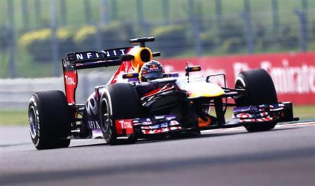 Red Bull Formula One driver Sebastian Vettel of Germany drives during the first practice session of the Indian F1 Grand Prix at the Buddh International Circuit in Greater Noida, on the outskirts of New Delhi, October 25, 2013. REUTERS/Ahmad Masood