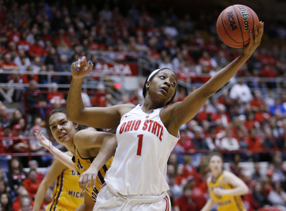 Ohio State forward Stephanie Mavunga, right, grabs a rebound against Central Michigan forward Reyna Frost during the first half of a second-round game in the NCAA women's college basketball tournament in Columbus, Ohio, Monday, March 19, 2018. (AP Photo/Paul Vernon)