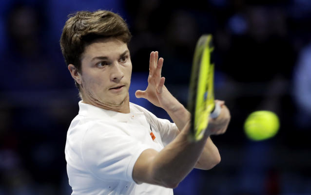 Miomir Kecmanovic of Serbia, returns the ball to Jannic Sinner of Italy, during the ATP Next Gen tennis tournament semifinal match, in Milan, Italy, Friday, Nov. 8, 2019. (AP Photo/Luca Bruno)