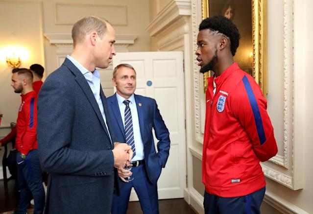 LONDON, ENGLAND - SEPTEMBER 07: Prince William, Duke of Cambridge (L) President of the Football Association, speaks with England U20 manager Paul Simpson (C) and Josh Onomah during a reception for the Under-20 England Football Team at Kensington Palace on September 7, 2017 in London, England. The England Under-20 side became the first England team to win a football World Cup since 1996 when they beat Venezuela 1-0 on June 11th, 2017. (Photo by Chris Jackson - WPA Pool/Getty Images)