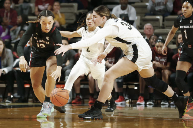 South Carolina guard Brea Beal (12) steals the ball from Vanderbilt forward Mariella Fasoula (34) in the first half of an NCAA college basketball game Sunday, Jan. 12, 2020, in Nashville, Tenn. (AP Photo/Mark Humphrey)