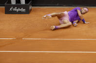 Spain's Rafael Nadal falls to ground after tripping over a lifted line of the court, during his final match against Djokovic at the Italian Open tennis tournament, in Rome, Sunday, May 16, 2021. (AP Photo/Gregorio Borgia)