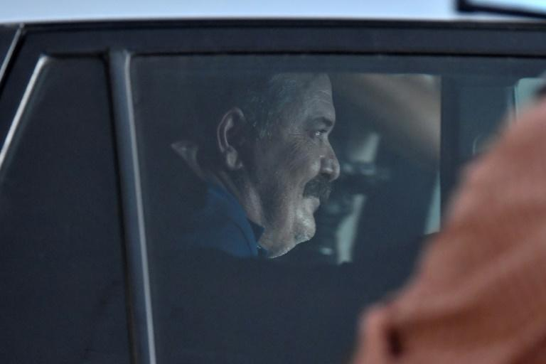 Golden Dawn's deputy leader Christos Pappas is taken to a prosecutor in Athens after evading justice since October