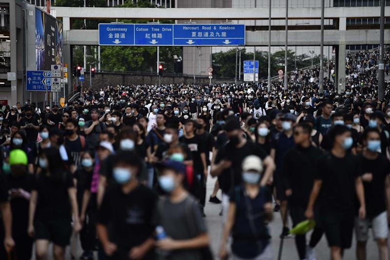 Protesters walk toward Hong Kong's Central district during a march against the controversial extradition bill (AFP/Getty Images)