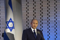 FILE - In this Sunday, Sept. 19 2021 file photo, Israeli Prime Minister Naftali Bennett speaks, at Mt. Herzl in Jerusalem. As Europe's economic powerhouse Germany embarks on the task of piecing together a new ruling coalition after the knife-edge election on Sunday Sept. 26, 2021, the country need only look to its neighbors, Belgium and the Netherlands, to see how tricky the process can be. Throughout Israel's 73-year history, no single party has ever controlled the parliamentary majority. That has resulted in a string of coalition governments, usually led by the largest party in parliament. (Ohad Zwigenberg/Pool via AP, file)