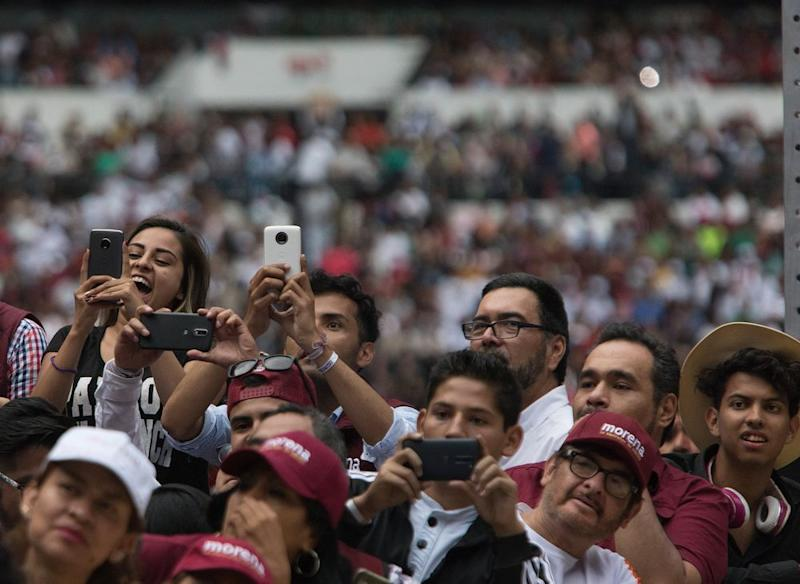 Supporters hold their mobile phones during a musical performance at López Obrador's last rally at the Estadio Azetca in Mexico City on June 27th.