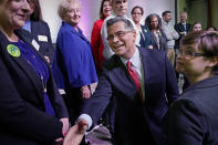 U.S. Department of Health and Human Services (HHS) Secretary Xavier Becerra, center, shakes hands with Oklahoma Medicaid advocates following a news conference Thursday, July 1, 2021, in Tulsa, Okla., as Oklahoma expands its Medicaid program. (AP Photo/Sue Ogrocki)