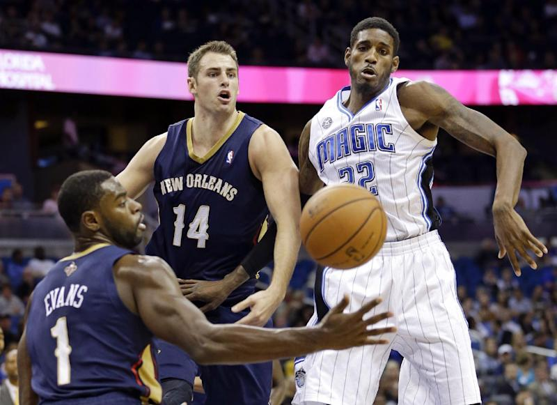 New Orleans Pelicans' Tyreke Evans (1) and Jason Smith (14) go after a rebound against Orlando Magic's Solomon Jones during the first half of an NBA preseason basketball game in Orlando, Fla., Friday, Oct. 25, 2013. (AP Photo/John Raoux)