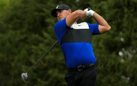 Brooks Koepka drives on the 11th hole - Credit: Getty Images North America
