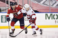 Florida Panthers center Aleksander Barkov (16) and Carolina Hurricanes right wing Jesper Fast (71) battle for position during the second period of an NHL hockey game, Monday, March 1, 2021, in Sunrise, Fla. (AP Photo/Wilfredo Lee)