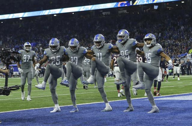 <p>The Detroit Lions form a dance line after a touchdown by wide receiver T.J. Jones (13) during the first half of an NFL football game against the Chicago Bears, Saturday, Dec. 16, 2017, in Detroit. (AP Photo/Rey Del Rio) </p>