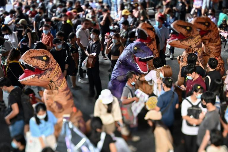 Thai protestors dressed as dinosaurs rally with students for reform of the education system