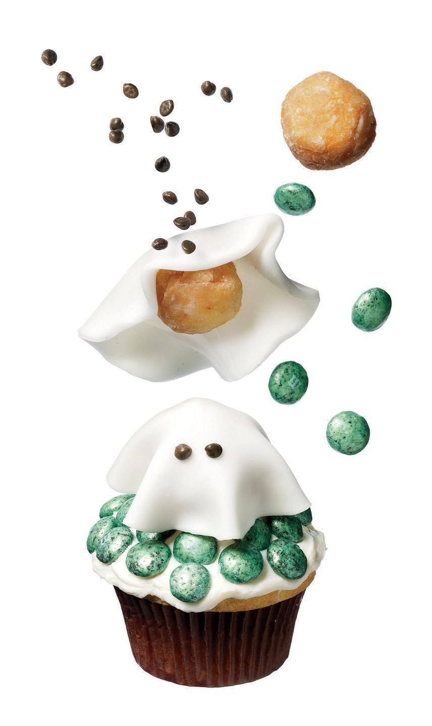 """<p>Float a fondant-covered doughnut hole on a bed of vanilla frosting dotted with mint chocolate M&M's for the sweetest ghost we've ever seen.</p><p><em><a href=""""https://www.womansday.com/food-recipes/food-drinks/recipes/a11455/friendly-ghost-cupcake-recipe-122729/"""" rel=""""nofollow noopener"""" target=""""_blank"""" data-ylk=""""slk:Get the recipe from Woman's Day »"""" class=""""link rapid-noclick-resp"""">Get the recipe from Woman's Day »</a></em></p>"""