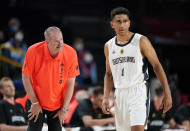 Germany head coach Henrik Rodl, left, interacts with player Maodo Lo during men's basketball preliminary round game against Italy at the 2020 Summer Olympics, Sunday, July 25, 2021, in Saitama, Japan. (AP Photo/Charlie Neibergall)