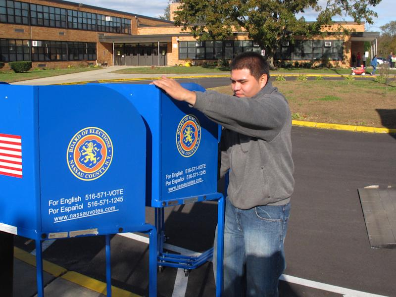 Cisco Guillen unloads voting machines outside Kramer Avenue Elementary School, Monday, Nov. 5, 2012, in Plainview, N.Y. The school will be one of Nassau County's polling places for the national elections being held on Tuesday. (AP Photo/Frank Eltman)
