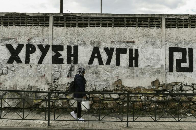 In Athens a wall is painted with the logo of neo-Nazi party Golden Dawn whose four-year-long trial could be nearing conclusion