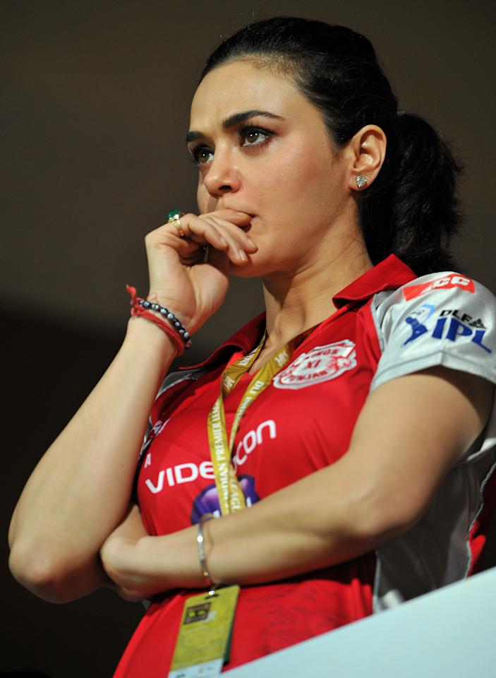 Bollywood actress and Kings XI Punjab (KXIP) co-owner Preity Zinta spends tense moments watching her team play during the IPL Twenty20 cricket match between Royal Challenger Bangalore and Kings XI Punjab at the M. Chinnaswamy Stadium in Bangalore on May 2, 2012. KXIP are chasing a target of 159 set by RCB.   AFP PHOTO / Manjunath KIRAN RESTRICTED TO EDITORIAL USE. MOBILE USE WITHIN NEWS PACKAGE        (Photo credit should read Manjunath Kiran/AFP/GettyImages)