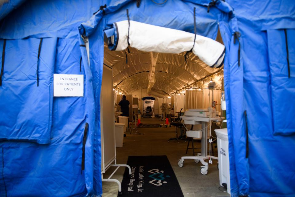 A field hospital tent for Covid-19 patient triage stands outside the emergency department of Martin Luther King Jr. Community Hospital in California. Source: Getty