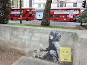 New Banksy 'masterpiece' on a wall in Marble Arch. A new piece of 'Banksy' artwork left after the Extinction Rebellion protesters left Marble Arch last week could be worth �1 million. If genuine - and art experts claim it is definitely him - it could sell for around �1million, but only if it can be removed. Westminster Council have now placed a protective perspex plate over the piece of street art as it had already been the subject of some defacement with red and blue writing and a yellow 'smiley' leaflet stuck to the wall. (Photo by Keith Mayhew / SOPA Images/Sipa USA)