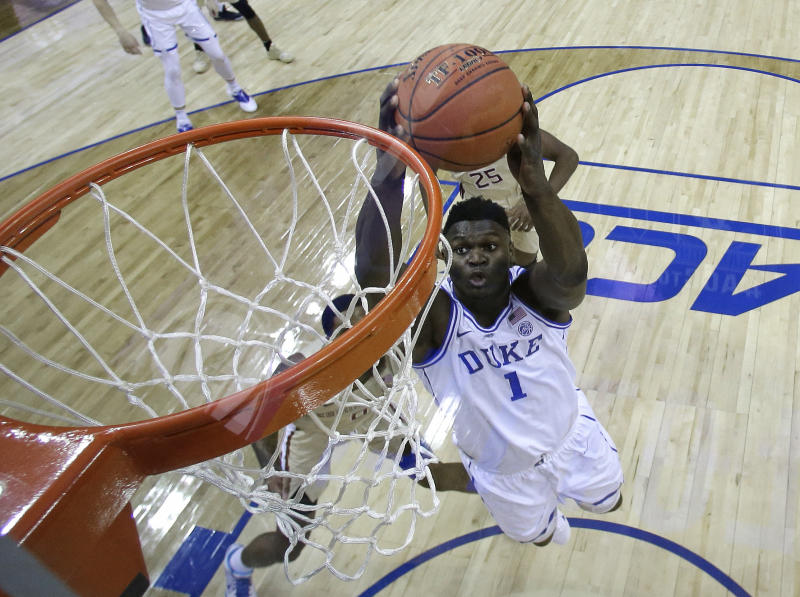 Duke's Zion Williamson (1) goes up to dunk against Florida State during the first half of the NCAA college basketball championship game of the Atlantic Coast Conference tournament in Charlotte, N.C., Saturday, March 16, 2019. (AP Photo/Chuck Burton)
