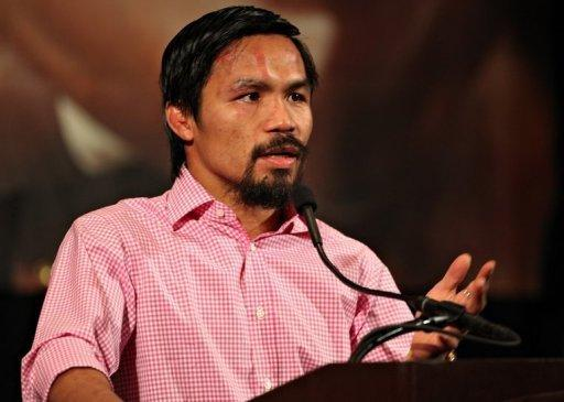 Manny Pacquiao addresses the media during the post-fight press conference