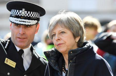 FILE PHOTO: Britain's Prime Minister Theresa May visits the city where former Russian intelligence officer Sergei Skripal and his daughter Yulia were poisoned with a nerve agent, in Salisbury, Britain March 15, 2018. REUTERS/Toby Melville/Pool/File Photo