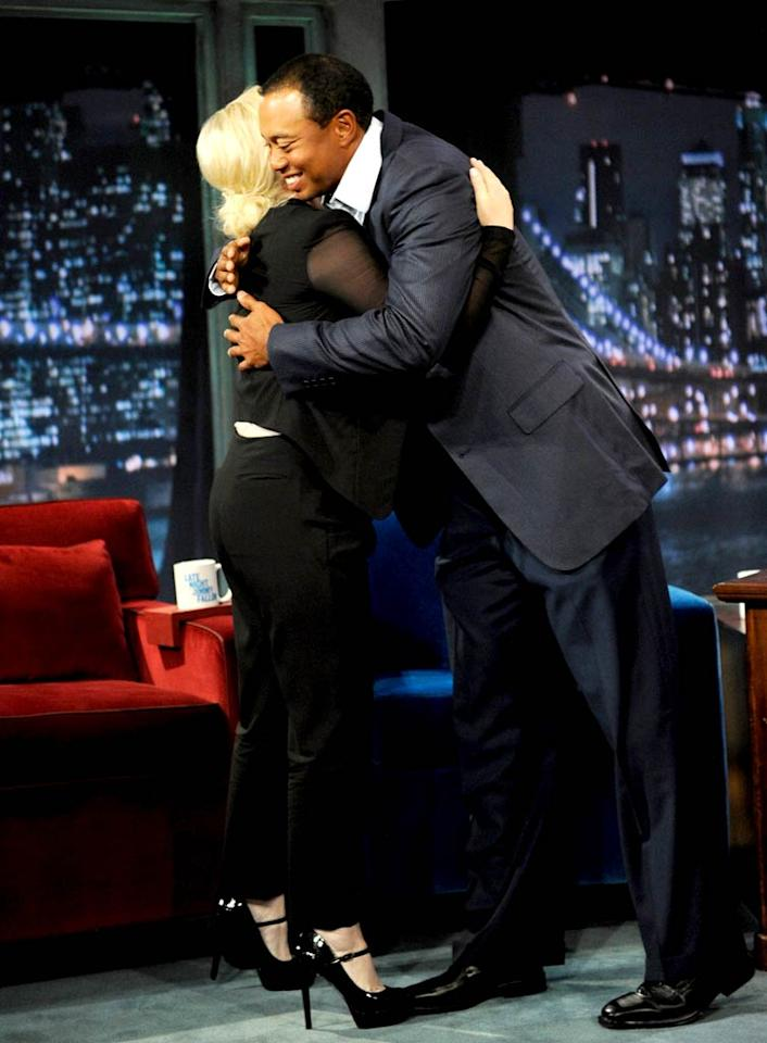 """Tiger Woods braved """"Late Night With Jimmy Fallon"""" on Wednesday, but first gave fellow guest Amy Poehler a hug before kicking off his interview. Kevin Mazur/<a href=""""http://www.gettyimages.com/"""" target=""""new"""">GettyImages.com</a> - March 16, 2011"""