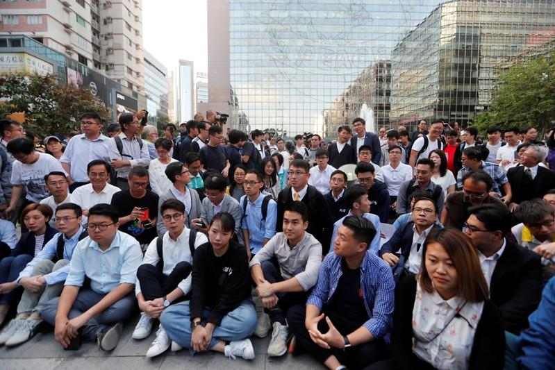 Pro-democratic winning candidates gather outside the campus of the Polytechnic University (PolyU) in Hong Kong