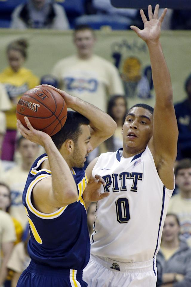 In this Oct. 25, 2013 photo, Pittsburgh's James Robinson, right, defends against UC San Diego's Aleks Lipovic in the first half of the exhibition NCAA college basketball game in Pittsburgh. Robinson plans to be a bigger part of the offense this season after the graduation of Tray Woodall. Robinson spent most of the summer working on his jump shot and coach Jamie Dixon believes Robinson can be one of the better all-around point guards in the ACC.(AP Photo/Keith Srakocic)