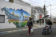 A mural of Lionel Messi is seen on a wall near the star's childhood home in Rosario, Santa Fe Province, some 350 km north of Buenos Aires