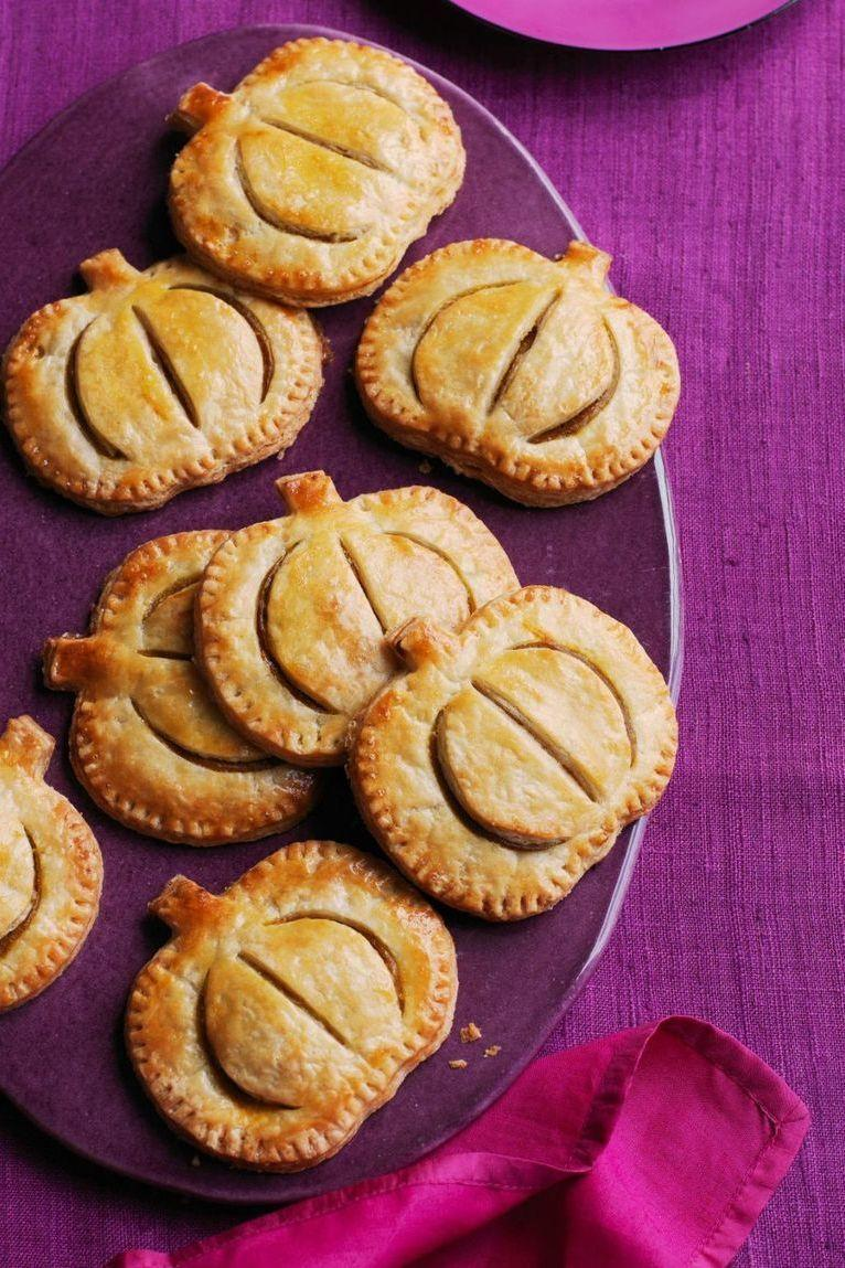 """<p>Can't servce up a bunch of pies? Try mini pies that are totally grab-and-go (and delicious!). </p><p><a href=""""https://www.womansday.com/food-recipes/food-drinks/recipes/a52046/pumpkin-hand-pies/"""" rel=""""nofollow noopener"""" target=""""_blank"""" data-ylk=""""slk:Get the Pumpkin Hand Pies recipe."""" class=""""link rapid-noclick-resp""""><strong><em>Get the Pumpkin Hand Pies recipe.</em></strong></a></p>"""