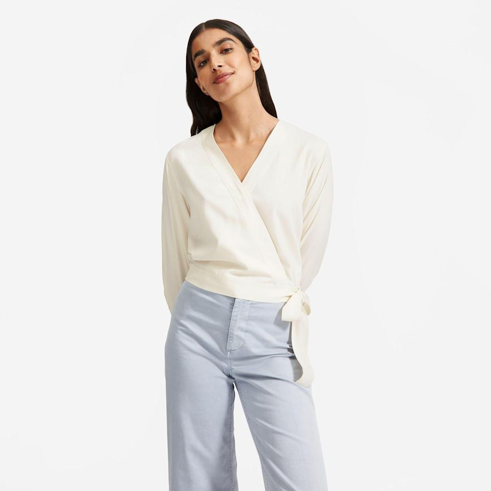 """<p><strong>Everlane</strong></p><p>everlane.com</p><p><a href=""""https://go.redirectingat.com?id=74968X1596630&url=https%3A%2F%2Fwww.everlane.com%2Fproducts%2Fwomens-washable-silk-wrap-top-bone&sref=https%3A%2F%2Fwww.harpersbazaar.com%2Ffashion%2Ftrends%2Fg37038622%2Feverlane-summer-sale-best-items%2F"""" rel=""""nofollow noopener"""" target=""""_blank"""" data-ylk=""""slk:Shop Now"""" class=""""link rapid-noclick-resp"""">Shop Now</a></p><p><del><strong>$110</strong></del><strong> $55</strong></p><p>You'll get weeks of work outfit mileage out of this washable silk blouse. Don't forget the <a href=""""https://www.harpersbazaar.com/fashion/trends/g37000643/best-workbags-amazon/"""" rel=""""nofollow noopener"""" target=""""_blank"""" data-ylk=""""slk:new bag"""" class=""""link rapid-noclick-resp"""">new bag</a> to match.<br></p>"""