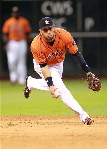 Houston Astros shortstop Marwin Gonzalez tosses the ball to second baseman Jose Altuve during the sixth inning of a baseball game against the Detroit Tigers Friday, May 3, 2013, in Houston. (AP Photo/Patric Schneider)