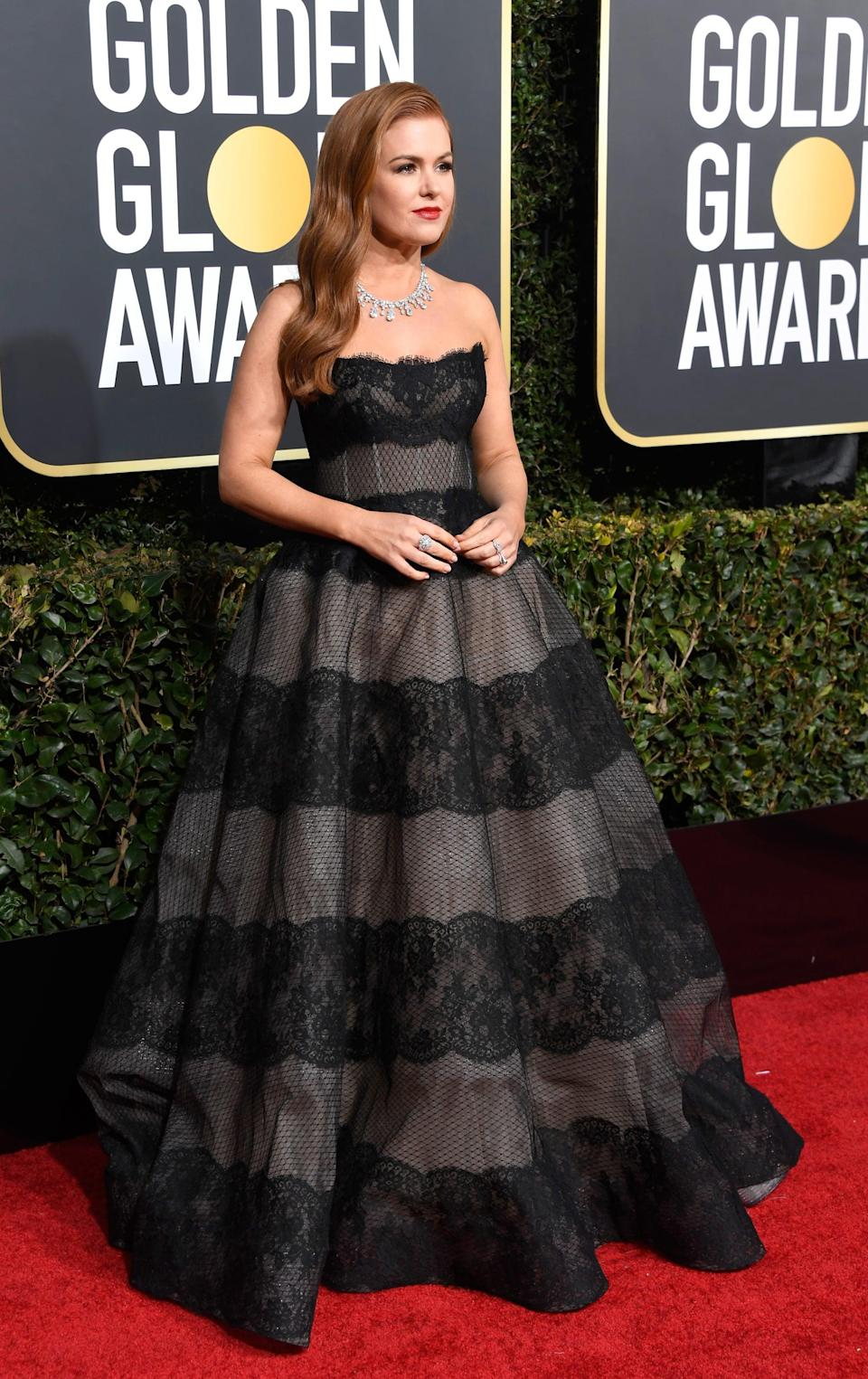 <p>Wearing a Monique Lhuillier dress with Harry Winston jewels.</p>