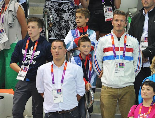 LONDON, ENGLAND - AUGUST 11: David Beckham and his sons Brooklyn Beckham, Romeo Beckham and Cruz Beckham meet members of Team GB the Men's 10m Platform Diving Final on Day 15 of the London 2012 Olympic Games at the Aquatics Centre on August 11, 2012 in London, England. (Photo by Pascal Le Segretain/Getty Images)