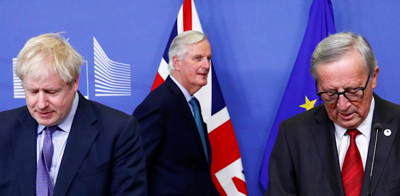 Britain's Prime Minister Boris Johnson, European Commission President Jean-Claude Juncker and European Union's chief Brexit negotiator Michel Barnier attend a news conference after agreeing on the Brexit deal, at the sidelines of the European Union leaders summit, in Brussels, Belgium October 17, 2019. REUTERS/Francois Lenoir