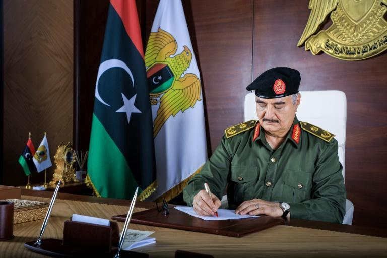 A handout picture released by the ibyan National Army on September 18, 2020, shows Gneral Khalifa Haftar, who waged a year-long assault on the capital in the west before reaching a formal ceasefire with his western opponents in October 2020 (AFP/-)
