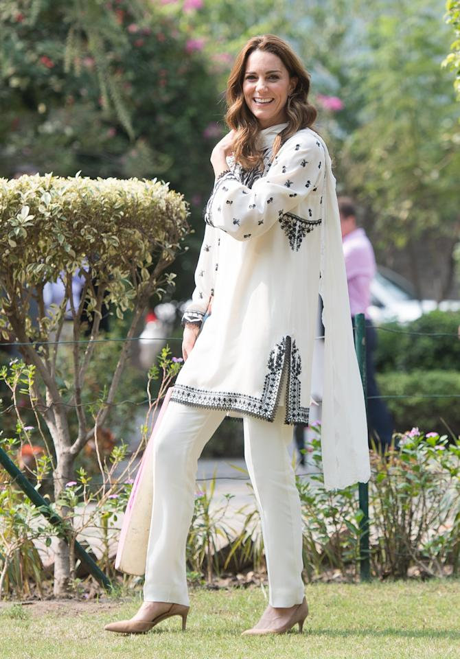"""<p>With her traditional Pakistani tunic and trousers, Kate slipped into her often go-to J.Crew nude suede heels ($218) for a game of cricket.</p> <p>Shop here: <a href=""""https://www.popsugar.com/buy/JCrew-Lucie-Suede-Pumps-538513?p_name=J.Crew%20Lucie%20Suede%20Pumps&retailer=jcrew.com&pid=538513&price=218&evar1=fab%3Aus&evar9=47074936&evar98=https%3A%2F%2Fwww.popsugar.com%2Fphoto-gallery%2F47074936%2Fimage%2F47075069%2FOct-18-2019&list1=celebrity%20style%2Ckate%20middleton%2Cthe%20royals%2Cthe%20british%20royals%2Cfashion%20shopping%2Caffordable%20shopping&prop13=api&pdata=1"""" rel=""""nofollow"""" data-shoppable-link=""""1"""" target=""""_blank"""" class=""""ga-track"""" data-ga-category=""""Related"""" data-ga-label=""""https://www.jcrew.com/p/womens_category/shoes/pumpsandheels/lucie-suede-pumps/G8128?color_name=ashen-brown"""" data-ga-action=""""In-Line Links"""">J.Crew Lucie Suede Pumps</a> ($218)</p>"""