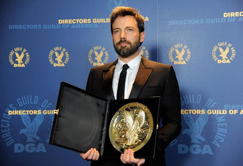 "Ben Affleck poses backstage with his award for outstanding directorial achievement in feature film for ""Argo"" at the 65th Annual Directors Guild of America Awards at the Ray Dolby Ballroom on Saturday, Feb. 2, 2013, in Los Angeles. (Photo by Chris Pizzello/Invision/AP)"