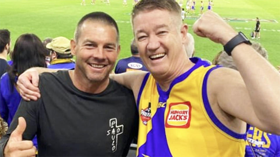 Ben Cousins, pictured here posing for photos at a West Coast Eagles game.