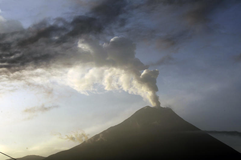 he Tungurahua volcano emits an an ash-filled plume as seen from Huambalo, Ecuador, Monday, Dec. 17, 2012.  The country's National Geophysics Institute says that a constant plume of gas and ash is rising about half a mile (1 kilometer) above the crater, with ash falling on nearby communities.  (AP Photo/Dolores Ochoa)